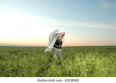 The groom and bride on a field