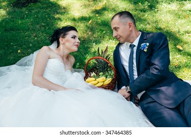 the groom and bride on the grass