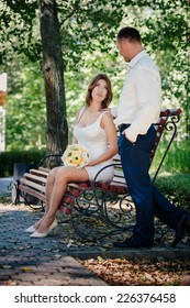 Groom and Bride in a park. wedding dress. Bridal wedding bouquet of flowers. Bride and Groom at wedding Day walking Outdoors on spring nature.  Loving wedding couple outdoor