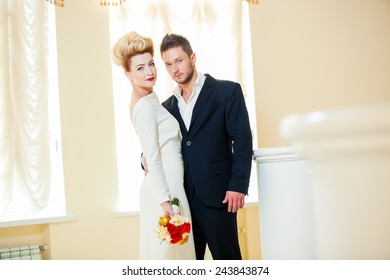 Groom and bride together. Wedding couple in room