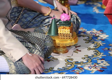 Groom and bride with tray of gift   in traditional Thai wedding ceremony. Concept of marriage.