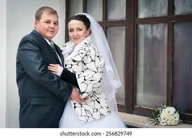 Groom and Bride. Wedding dress. Bridal wedding bouquet of flower