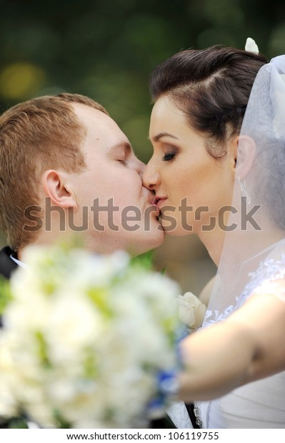 groom and bride in white dress with wedding bouquet