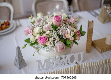 Groom and bride's table arrangement at wedding reception.