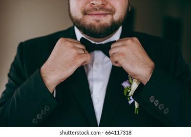 Groom dresses a suit