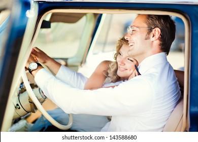 Groom drive retro car. Wedding.