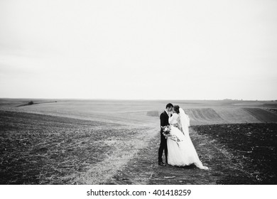 Groom is embrace his future wife
