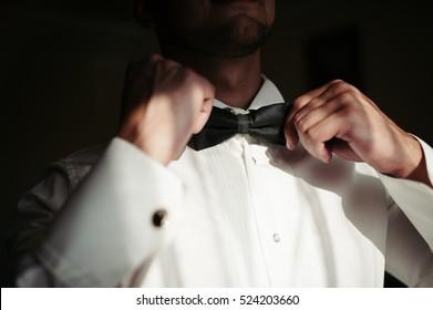 Groom getting ready for wedding ceremony.