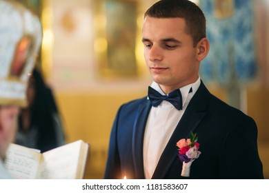 groom give a vow of love in the church