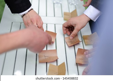 groom and groomsmen collecting papers with letters in word