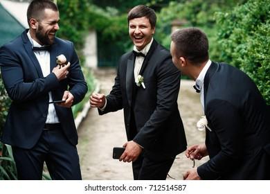 Groom and groomsmen look funny standing in the garden