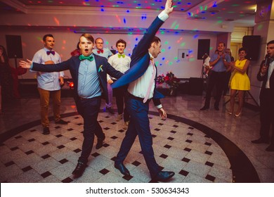 Groom and groomsmen walk on the dancefloor to start the performance