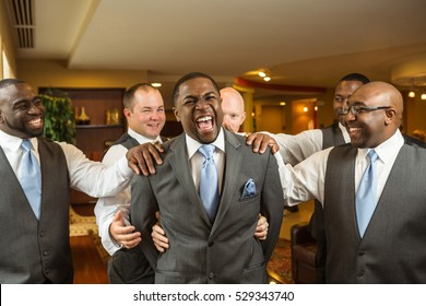 Groom and groomsmen at a wedding.
