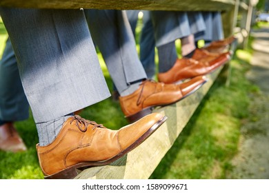 groom and his best friends. Brown leather men's shoes