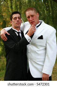 Groom and his bestman being silly.
