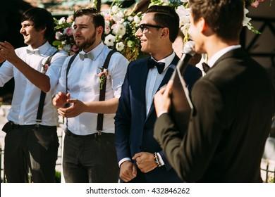 Groom and his groomsmen on the wedding ceremony