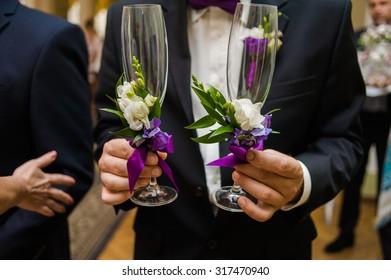 groom holding champagne on wedding ceremony
