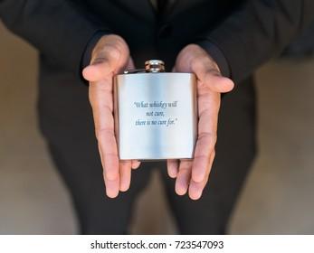 Groom Holding Flask
