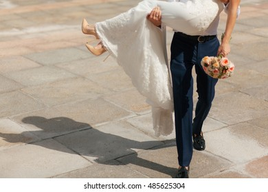 Groom is holding his wife in the wedding day