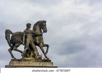 Groom and horse, a statue from Jena bridge in front of the Eiffel Tower .  Paris. France