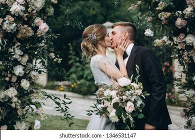 Groom kissing bride on wedding ceremony