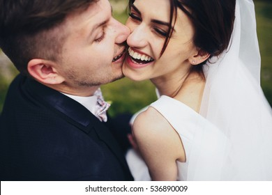 The groom kissing his bride