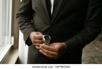 Groom looking for wedding hand-wrist watch