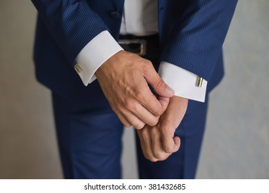 groom, man correct sleeves on shirt, hands close-up, dressing, man's style,