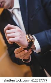 Groom man wears a watch