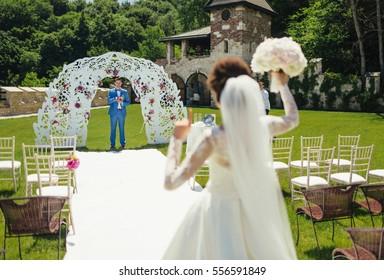 The groom near wedding archway
