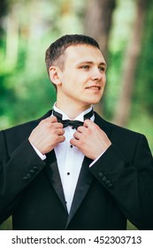 groom portrait on a autumn park at a wedding day.pleasant view