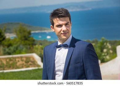 groom portrait on a park at a wedding day