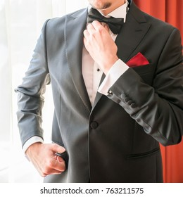 groom preparation details. bow-tie, hands and cuff-links details