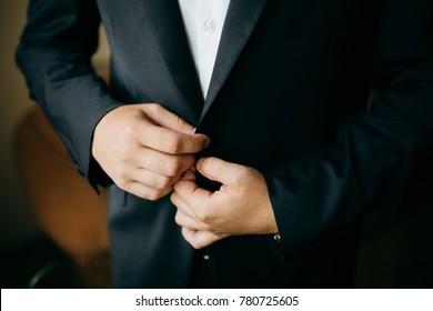 groom prepares for wedding