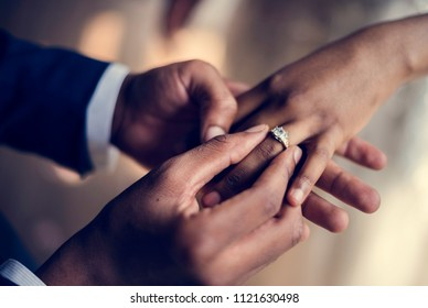Groom Put on Wedding Ring Bride Hand