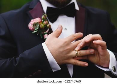 groom shoing wedding ring