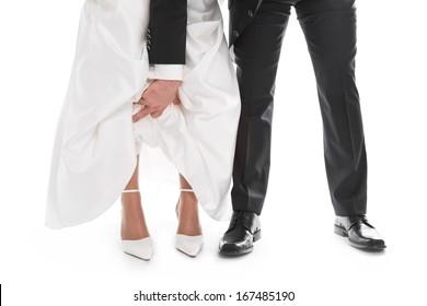 Groom is showing bride's feet, shoe, dress - wedding, marriage.