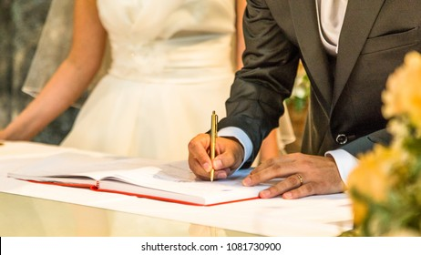 Groom sign on registration of marriage