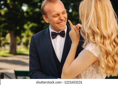 Groom smile to his bride and hud her. Just Married couple