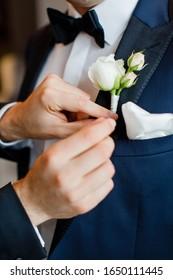 Groom in suit before wedding ceremony. Groom getting ready