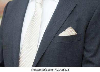 Groom suit without flowers before wedding. Black groom suit.