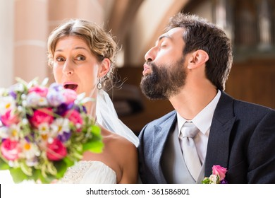 Groom trying to kiss bride in church