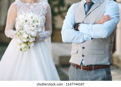 groom waiting for bride with wedding bouquet