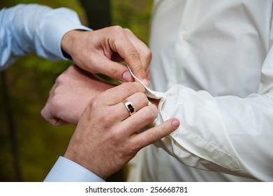 Groom wearing cufflink