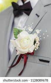 Groom with weddding buttonhole. Shallow depth of field.
