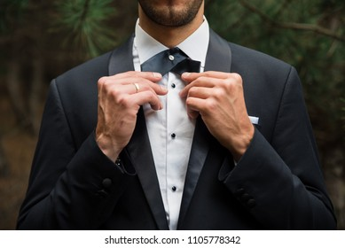 Groom at wedding tuxedo in the forest