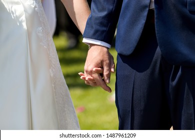 groome and bride holding his hands