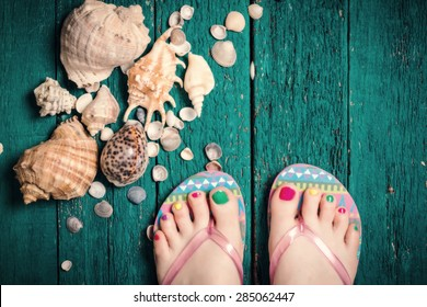 Groomed feet with a pedicure.Summer concept holiday,Vintage style