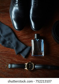 Groom's accessories: shoes, perfumes, watch, bow tie, belt, all black