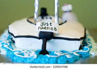 Grooms cake decorated as boat with Just Married sign on the back motor